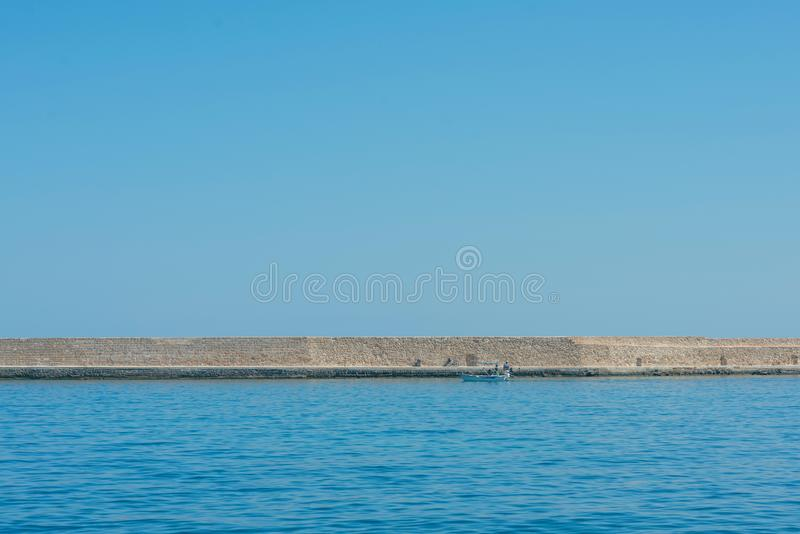 Panoramic view of the antiquity lighthouse in the old Venetian harbor Of Chania. Island of Crete. Greece stock images