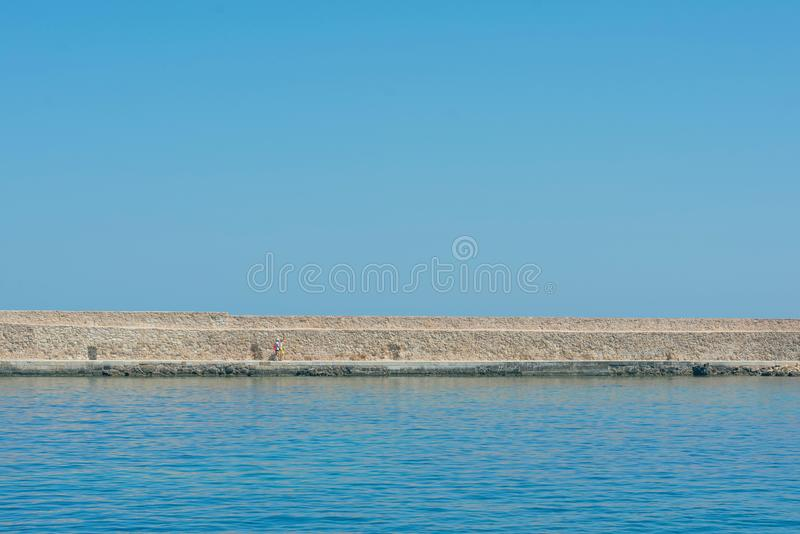 Panoramic view of the antiquity lighthouse in the old Venetian harbor Of Chania. Island of Crete. Greece stock photo