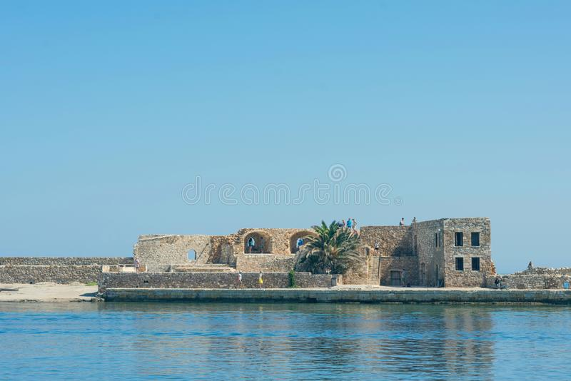 Panoramic view of the antiquity lighthouse in the old Venetian harbor Of Chania. Island of Crete. Greece royalty free stock photos