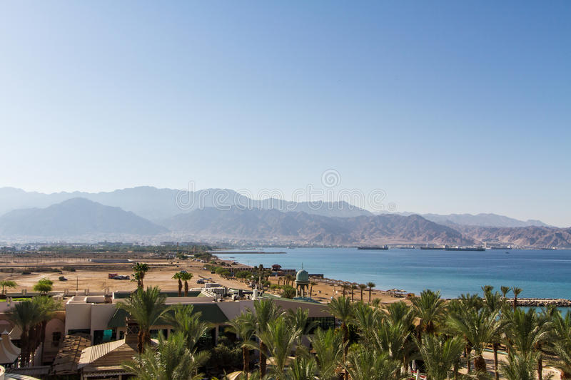 Panoramic view on Aqaba from central beach of Eilat . royalty free stock images