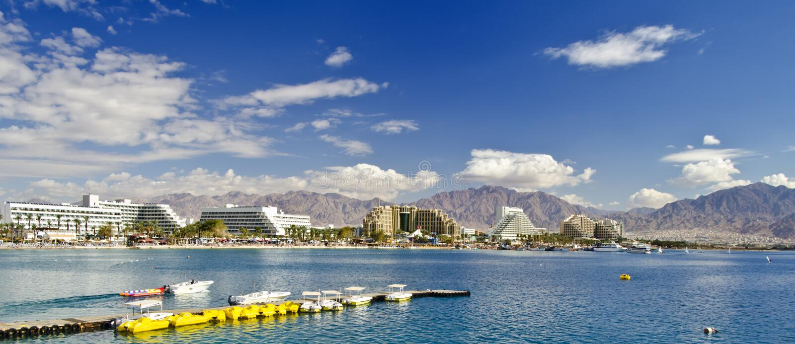 Panoramic view on Aqaba gulf, Eilat, Israel. The shot was taken from the northern beach of Eilat city - famous resort and recreation city in Israel royalty free stock photography