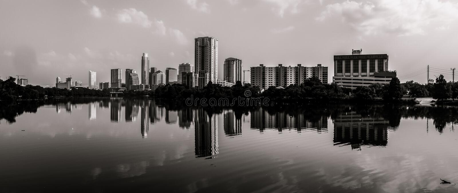 Panoramic View of Austin Texas Skyline monochrome. A Panoramic View of Austin Texas Skyline in a monochrome finish. TOwn lake was perfectly still and office royalty free stock images