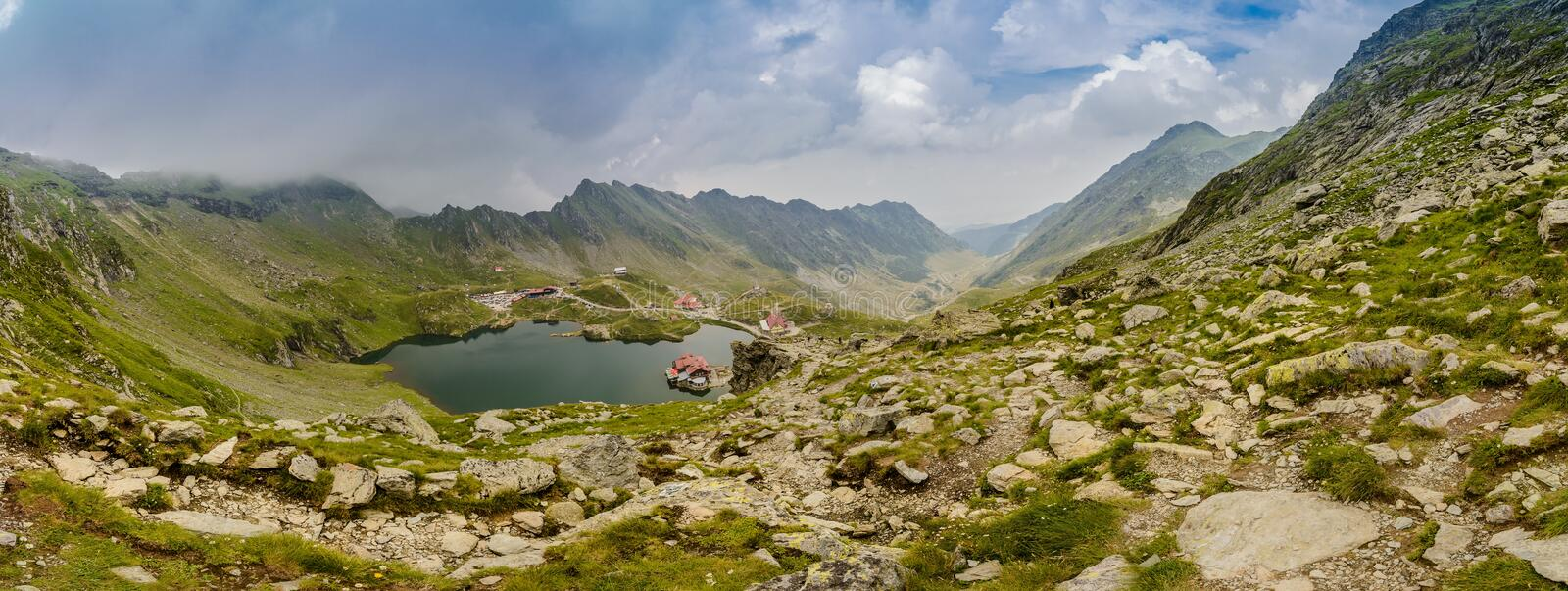 Panoramic view on Balea Lake and Transfagarasan Road stock image