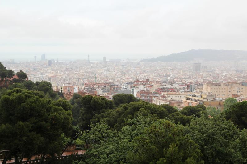 A panoramic view of Barcelona from Park Guell. The Park Güell is a public park system composed of gardens and architectonic elements located on Carmel Hill stock photos