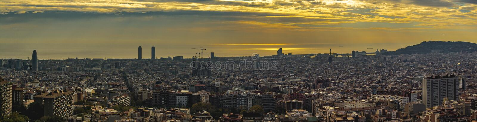 Panoramic view of Barcelona at sunset. Panoramic view of Barcelona at sunset from mountain of Turo de ls Rovira in a summer afernoon royalty free stock photo