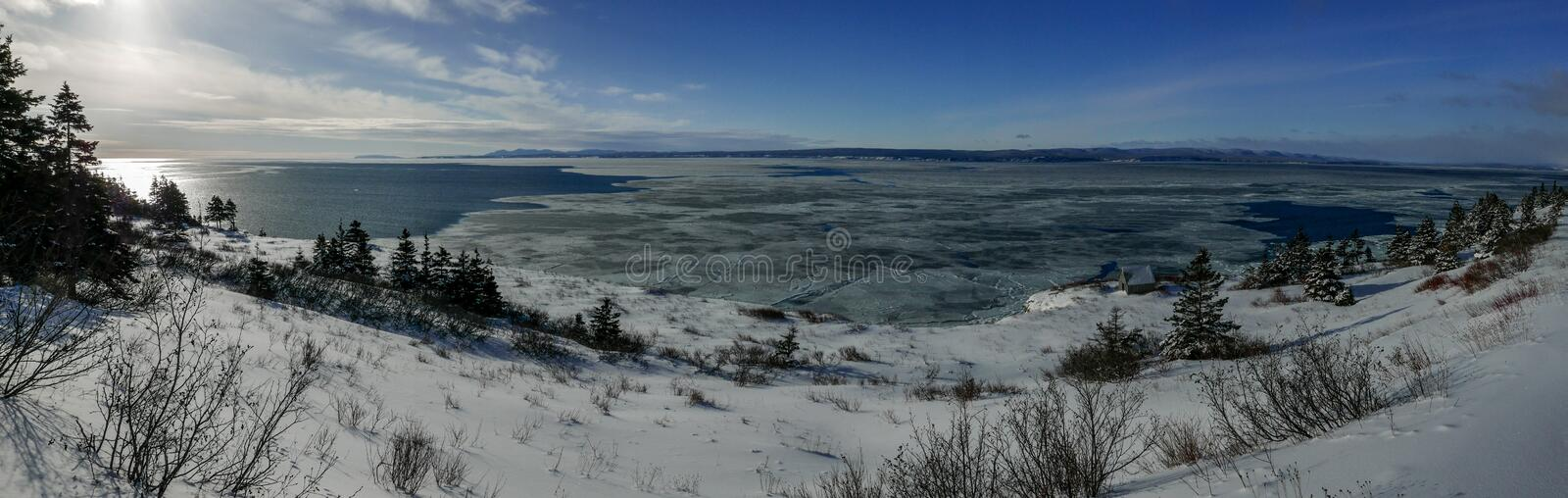 Panoramic view of the Bay of Gaspe taken from Cap Gaspe. Panoramic view of the Bay of Gaspe, Quebec, Canada on a sunny winter day taken from Cap Gaspe stock photo