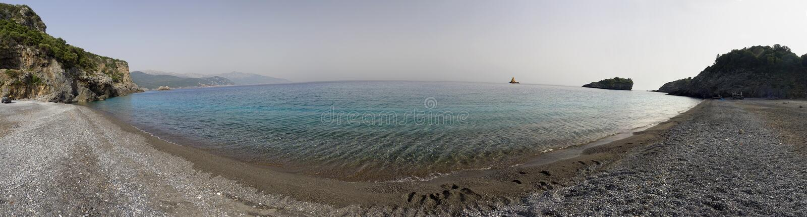 Panoramic view Beautiful beach with clear turquoise water on a sunny day in the Aegean Sea on the Evia island a in. Panoramic view beach with clear turquoise royalty free stock photo
