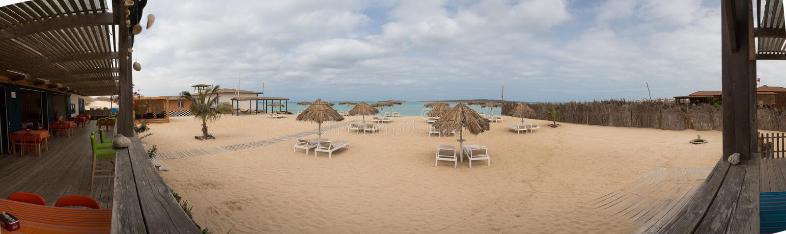 Panoramic view beach of island Boa Vista, Cape Verde. Panoramic view from restaurant to the beach, Boa Vista Island, Cape Verde. Collected from 17 photos royalty free stock photo