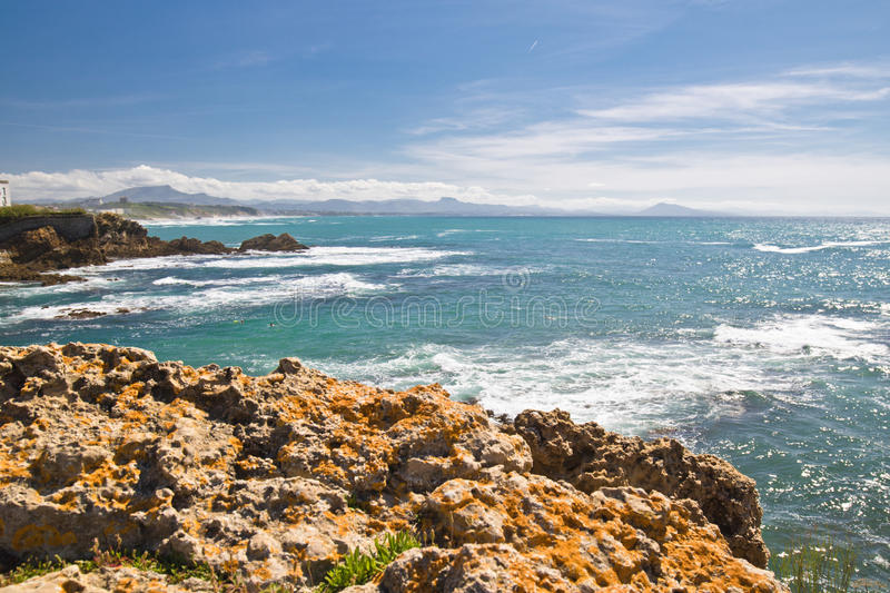 Panoramic view on beautiful atlantic coastline with turquoise ocean and mountains in basque country, biarritz, france stock images