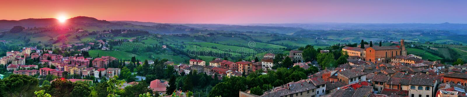 Panoramic view of beautiful landscape with the medieval city of San Gimignano at sunset in Tuscany, province of Siena, Italy stock images