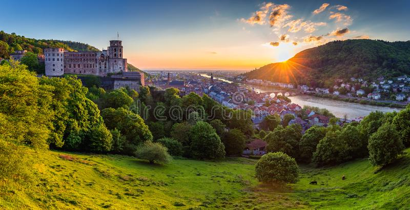 Panoramic view of beautiful medieval town Heidelberg including C. Arl Theodor Old Bridge, Neckar river, Church of the Holy Spirit, Germany stock photo