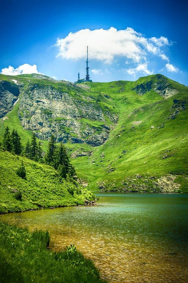 Panoramic view of beautiful mountain range with crystal clear lake. Panoramic view of beautiful mountain range with crystal clear turquoise lake. Pesica lake stock photography
