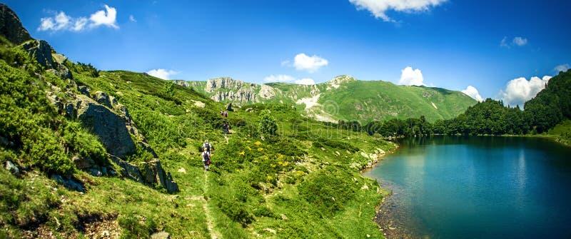 Panoramic view of beautiful mountain range with crystal clear lake. Panoramic view of beautiful mountain range with crystal clear turquoise lake. Pesica lake royalty free stock images