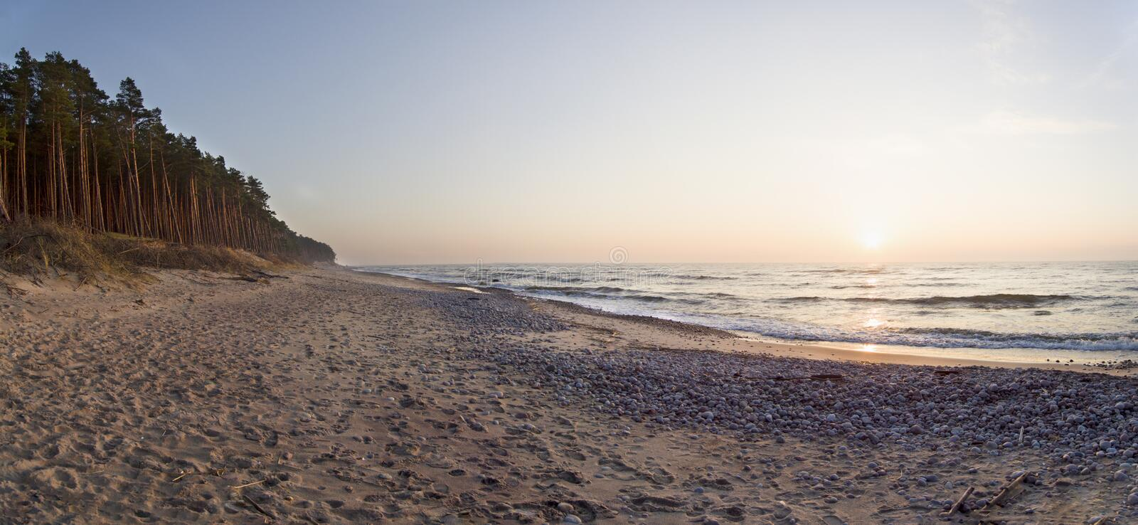 Panoramic view Beautiful sunset on the sandy beach of the Baltic Sea in Lithuania, Klaipeda royalty free stock photos