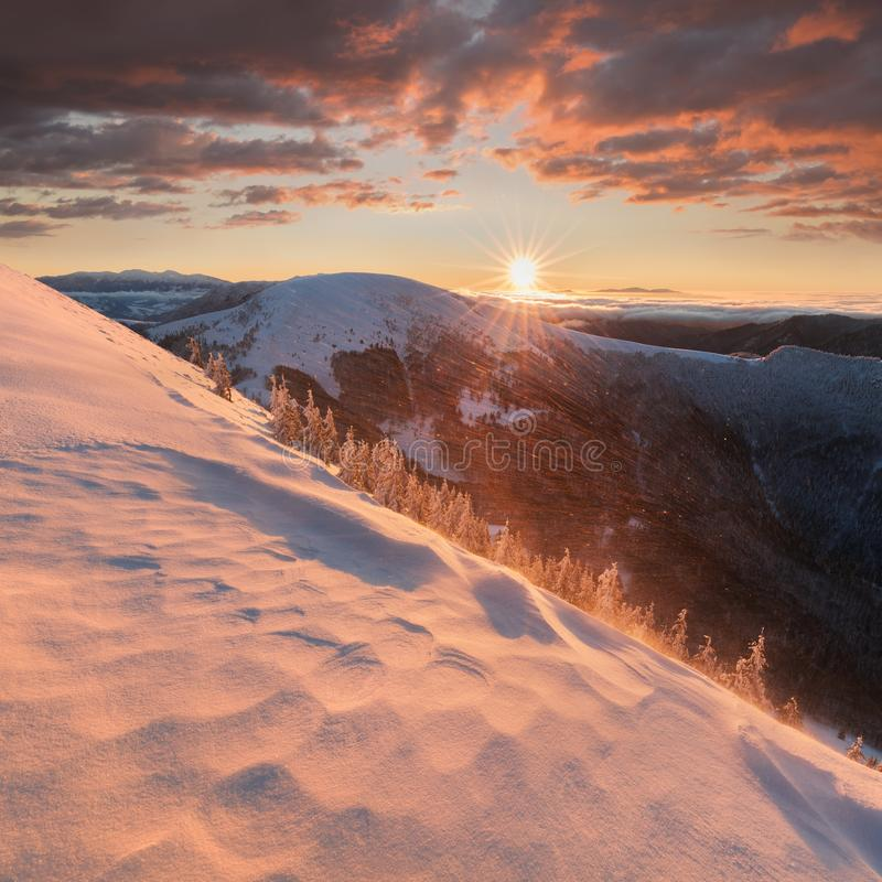 Panoramic view of beautiful winter wonderland mountain scenery in evening light at sunset. Mountains above the clouds. Christmas. Panoramic view of beautiful stock image