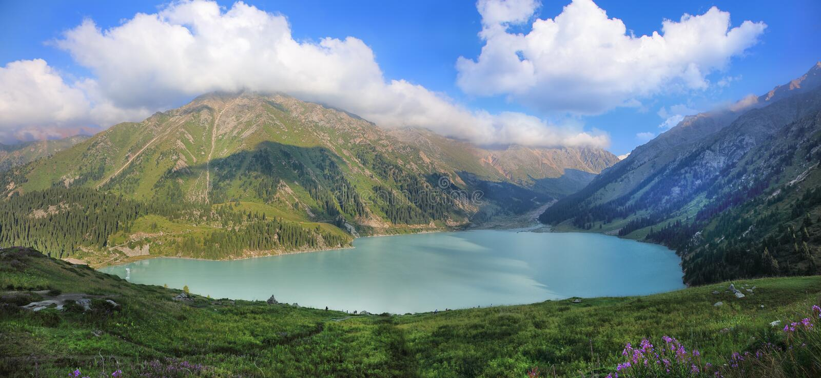 Big Almaty lake surrounded by the Tien Shan mountains royalty free stock photos