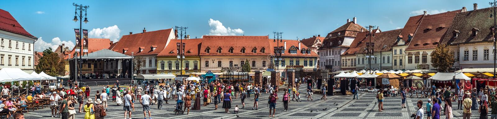 Panoramic view of the Big Square during Medieval Festival 2019. Sibiu City, Romania - 25 August 2019. Panoramic view of the Big Square from Sibiu during the stock photo