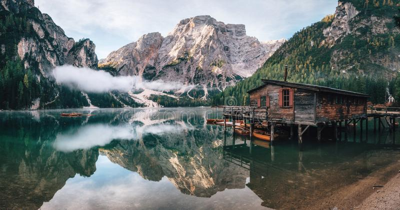Panoramic view of Braies Lake in Dolomites, Italy. Panoramic view of Braies Lake with the hut and boats in Dolomites mountains and Seekofel in the morning royalty free stock photo