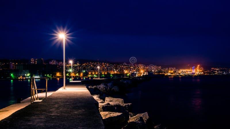Panoramic view from the breakwater, entrance to the Port of Rijeka..Night shoot, Rijeka, Croatia. Panoramic view from the breakwater, entrance to the Port of royalty free stock photos