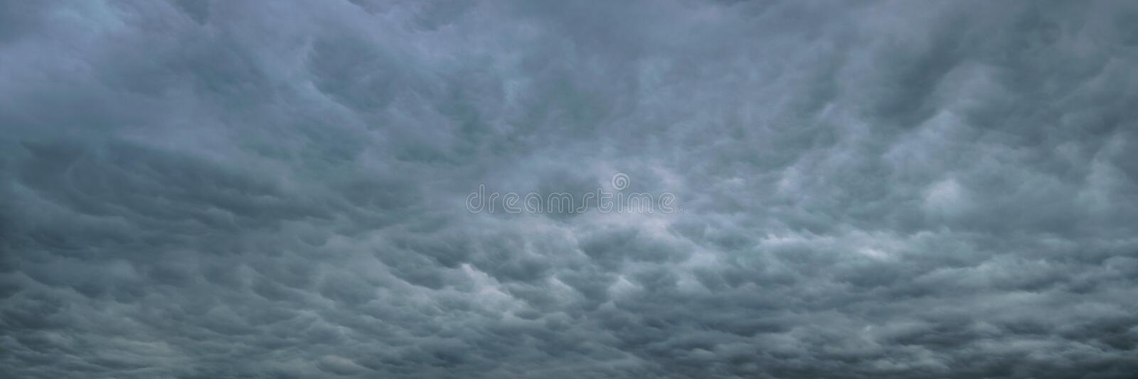Panoramic view of bubbles in the sky, also called mammatus clouds. View of a dramatic sky with a field full of mammatus clouds stock images