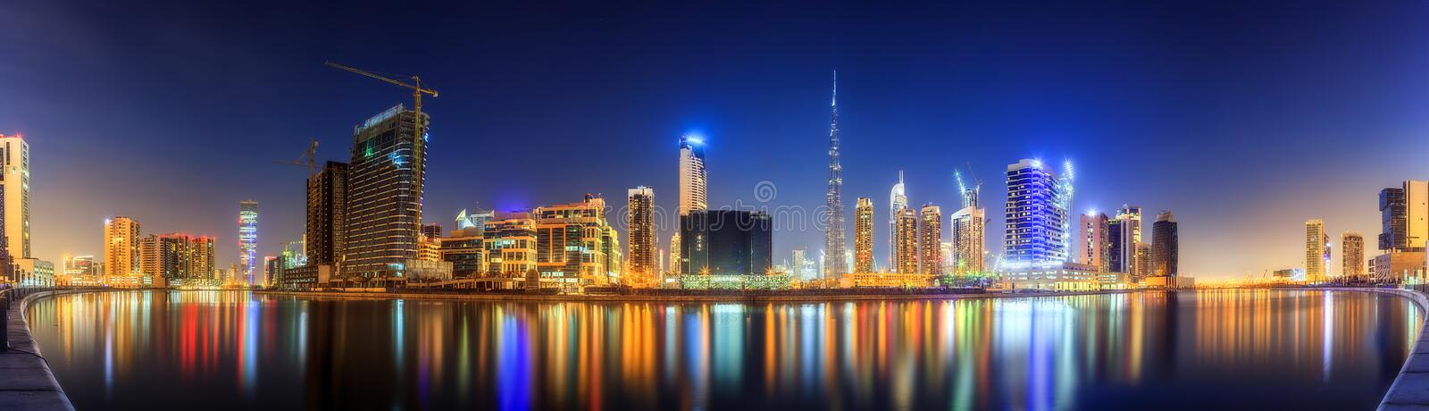 Panoramic view of Business bay and downtown area of Dubai, reflection in a river, UAE stock image