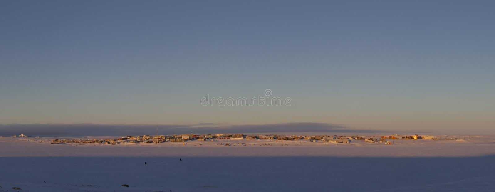 Panoramic view of Cambridge Bay, Nunavut, a far northern arctic community, during an early morning sunrise stock images
