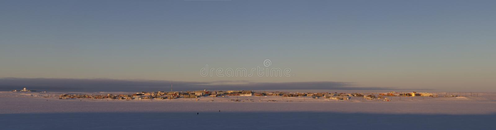 Panoramic view of Cambridge Bay, Nunavut, a far northern arctic community, during an early morning sunrise stock image