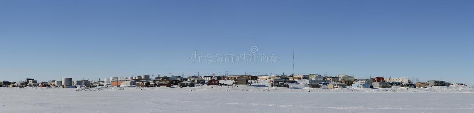 Panoramic view of Cambridge Bay, Nunavut, a far northern arctic community, during a sunny winter day stock photography
