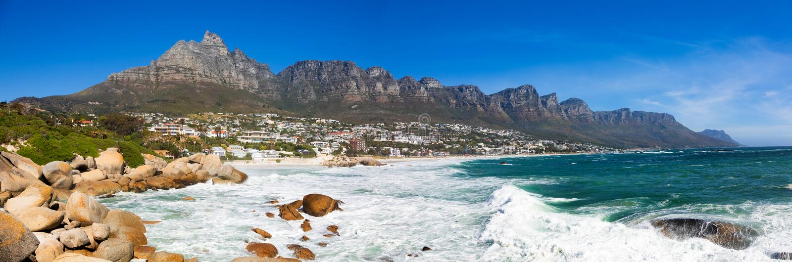 Panoramic view of Camps Bay Beach and Table Mountain in Cape Town South Africa. Panoramic side view of Camps Bay Beach and Table Mountain in Cape Town South stock photos