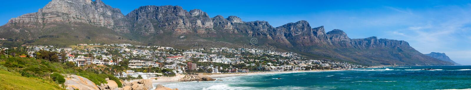 Panoramic view of Camps Bay Beach and Table Mountain in Cape Town South Africa. Panoramic side view of Camps Bay Beach and Table Mountain in Cape Town South stock photo