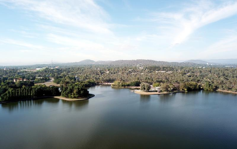 Panoramic view of Canberra Australia in daytime. Featuring Lake Burley Griffin and Parliament House royalty free stock photos