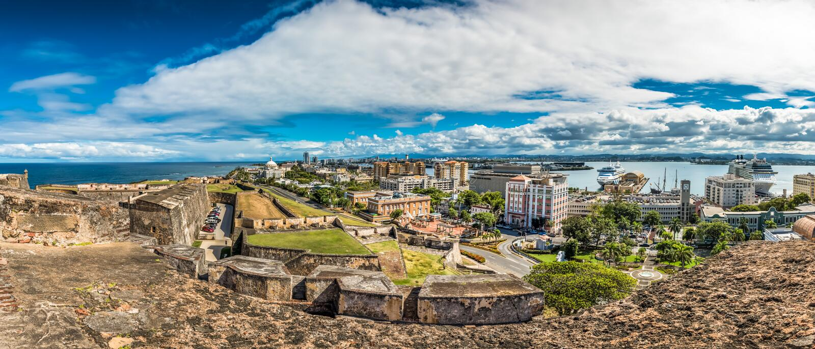 Panoramic view from Castillo de San Cristobal. Of the harbor and the old town plaza royalty free stock photos