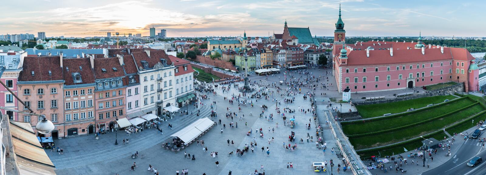 Panoramic view of Castle Square in Warsaw, Poland, as the sun begins to set over the Old Town stock photography