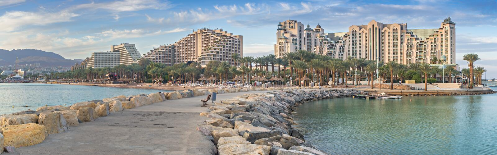Panoramic view on the central beach of Eilat. Eilat is a famous Israeli city with beautiful beaches and resort hotels packed with thousands of vacationers and royalty free stock photography