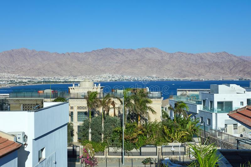 Panoramic view on the central public beach of Eilat - famous resort city. In Israel, blue, boat, sky, water, nature, coastline, travel, mountain, sea, tourist stock images