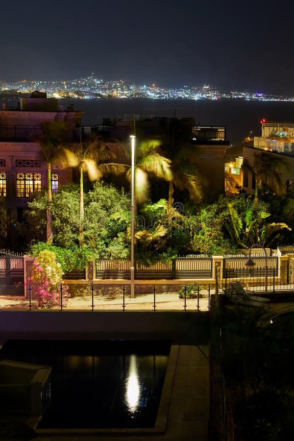 Panoramic view on the central public beach of Eilat - famous resort city. In Israel, hotels, red, sea, night, town, south, lights, panorama, port, boats, water royalty free stock photography
