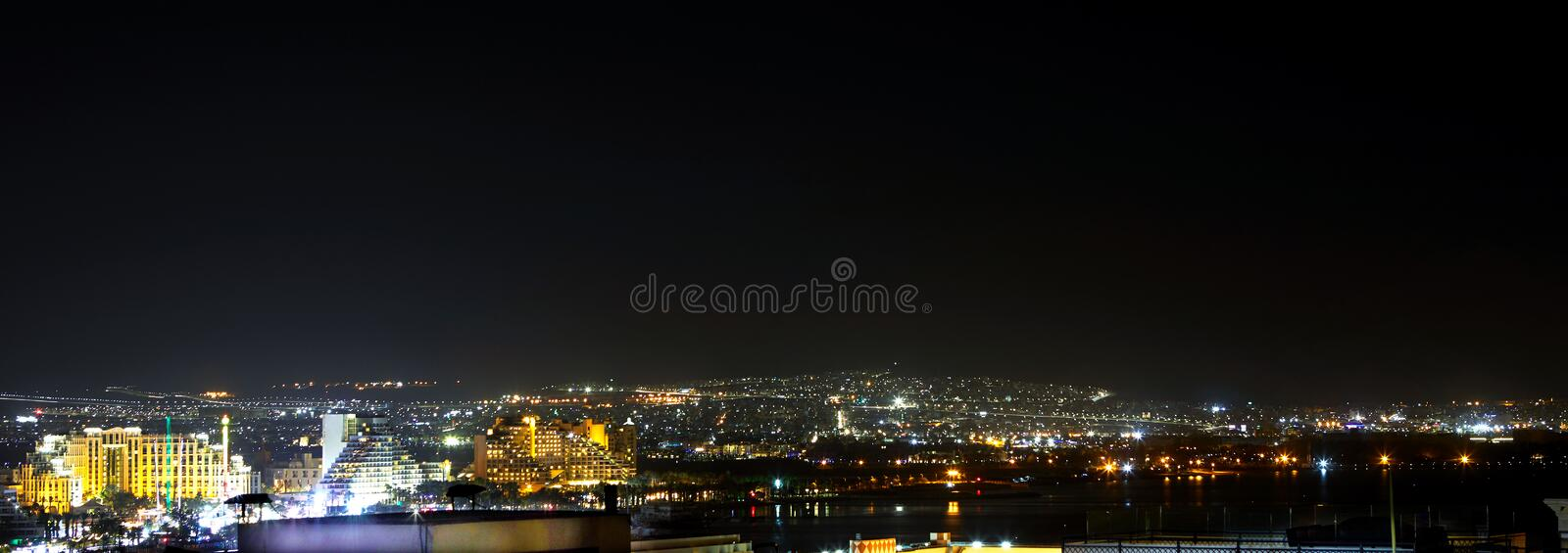 Panoramic view on the central public beach of Eilat - famous resort city. In Israel, hotels, red, sea, night, town, south, lights, panorama, port, boats, water royalty free stock image