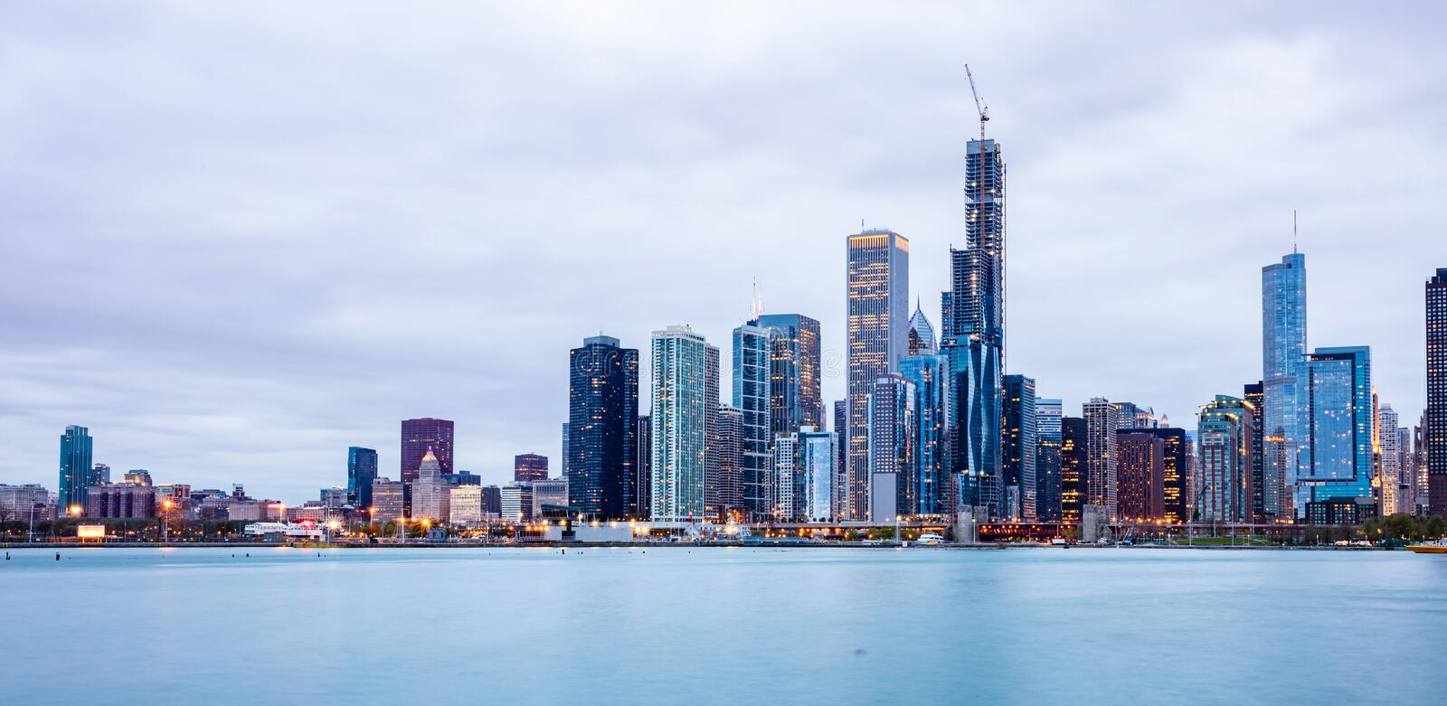 Panoramic view of Chicago city high rise buildings cloudy sky in the evening royalty free stock photo