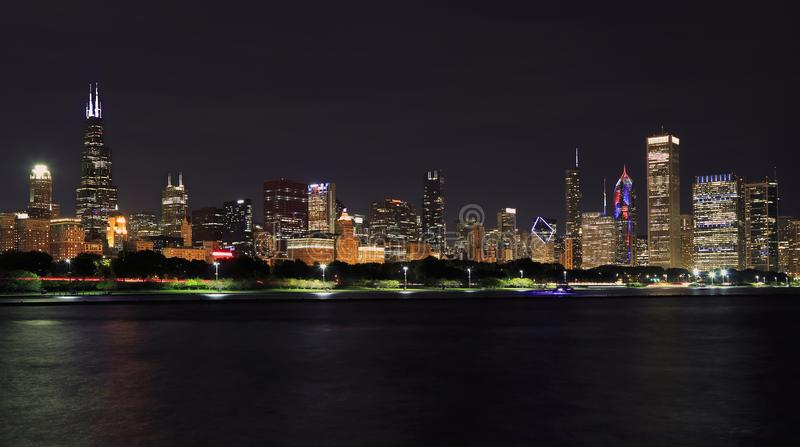 Panoramic view of Chicago skyline at night with Lake Michigan on the foreground. IL, USA stock images