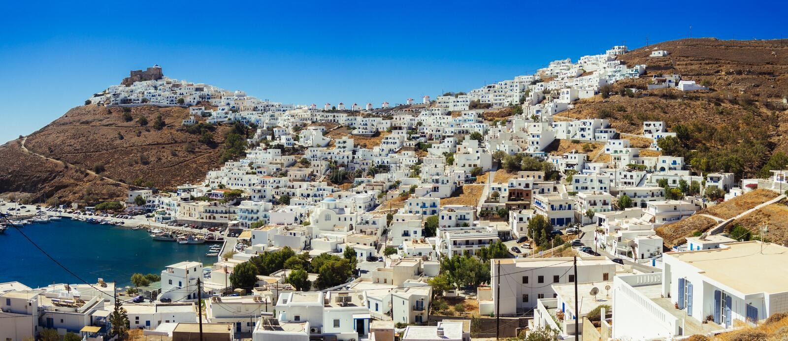 A panoramic view of the Chora of Astypalaia island with the harbor ,the castle and the windmills royalty free stock photos