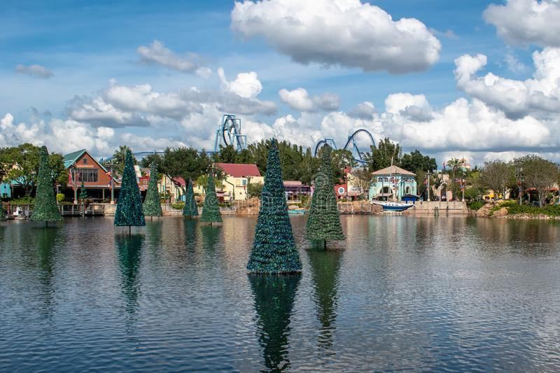 Panoramic view of Christmas trees on lake and colorful buildings at Seaworld 6. stock photos