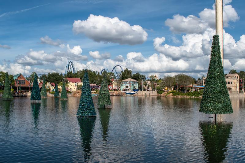 Panoramic view of Christmas trees on lake and colorful buildings at Seaworld 5 royalty free stock photography