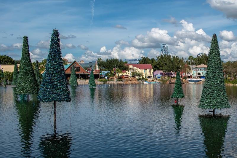 Panoramic view of Christmas trees on lake and colorful buildings at Seaworld 1 stock photo