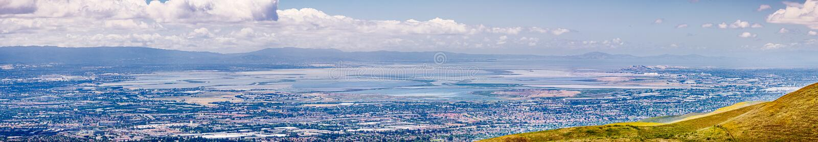 Panoramic view of the cities on the shoreline of south San Francisco bay area; colorful salt ponds in the background; Silicon. Valley, California stock photos