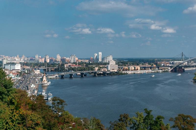 Panoramic view on city center of Kiev near the Arch of Friendship of Peoples from the glass bridge stock photography