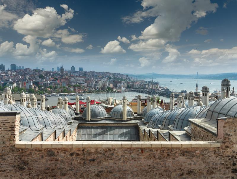 Panoramic view of city Istanbul, Bosphorus bridge from Galata tower.Turkey. View of outer view of dome in Ottoman architecture. Roofs of Istanbul. Suleymaniye stock photography