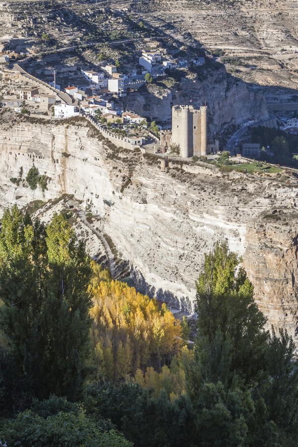 Panoramic view of the city, on top of limestone mountain is situated Castle of the 12TH century Almohad origin, take in. Alcala del Jucar, Spain - October 29 stock images
