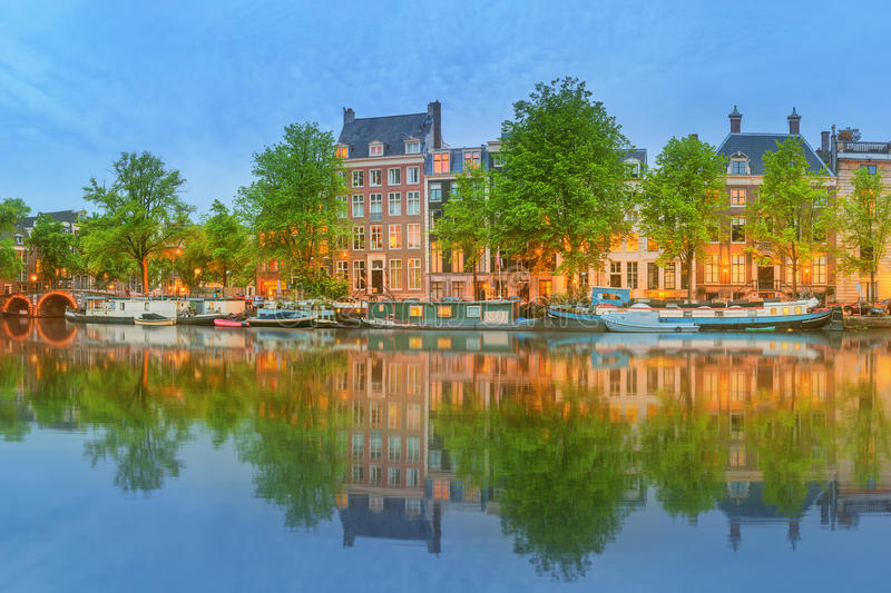 Panoramic view and cityscape of Amsterdam with boats, old buildings and Amstel river, Holland, Netherlands royalty free stock photo