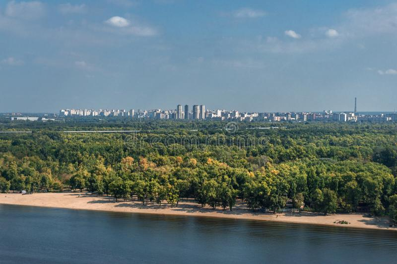 Panoramic view of the cityscapes, Dnipro river andleft bank and green trees in Kyiv, Ukraine. Panoramic  view of the cityscapes, Dnipro river andleft bank and stock image