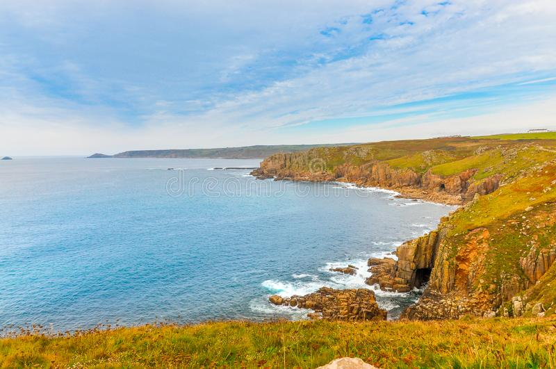 Panoramic view of the cliffs of Lands End. Spectacular panoramic view of the cliffs of Lands End in Cornwall, United Kingdom royalty free stock photos